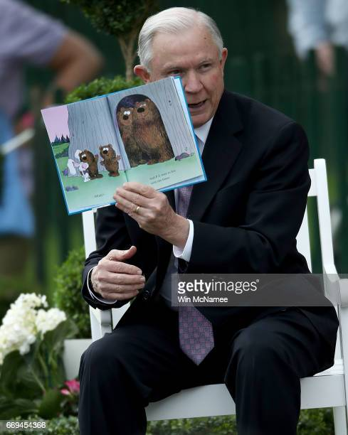 S Attorney General Jeff Sessions reads to children from the book 'It's Not Easy Being a Bunny' during the 139th Easter Egg Roll on the South Lawn of...