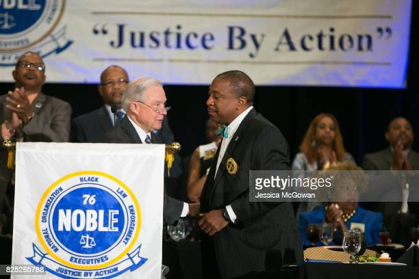 Attorney General Jeff Sessions shakes hands with Clarence E Cox III NOBLE First Nation Vice President after finishing a speech to law enforcement...