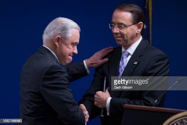 S Attorney General Jeff Sessions shakes hands with Deputy Attorney General Rod Rosenstein during a news conference on efforts to reduce transnational...