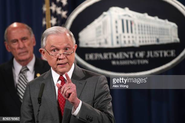 S Attorney General Jeff Sessions speaks as Director of National Intelligence Dan Coats listens during an event at the Justice Department August 4...