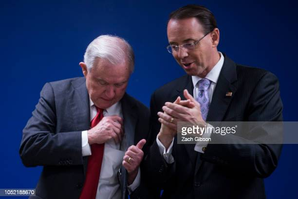 S Attorney General Jeff Sessions speaks to Deputy Attorney General Rod Rosenstein following a news conference on efforts to reduce transnational...