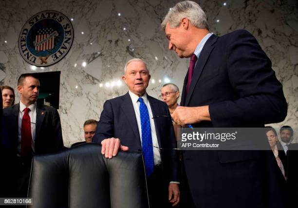 US Attorney General Jeff Sessions speaks with US Senator Sheldon Whitehouse Democrat of Rhode Island as he arrives to testify during a Senate...