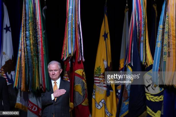 S Attorney General Jeff Sessions stands for the playing of the national anthem during the 65th Annual Attorney General's Awards Ceremony at the...