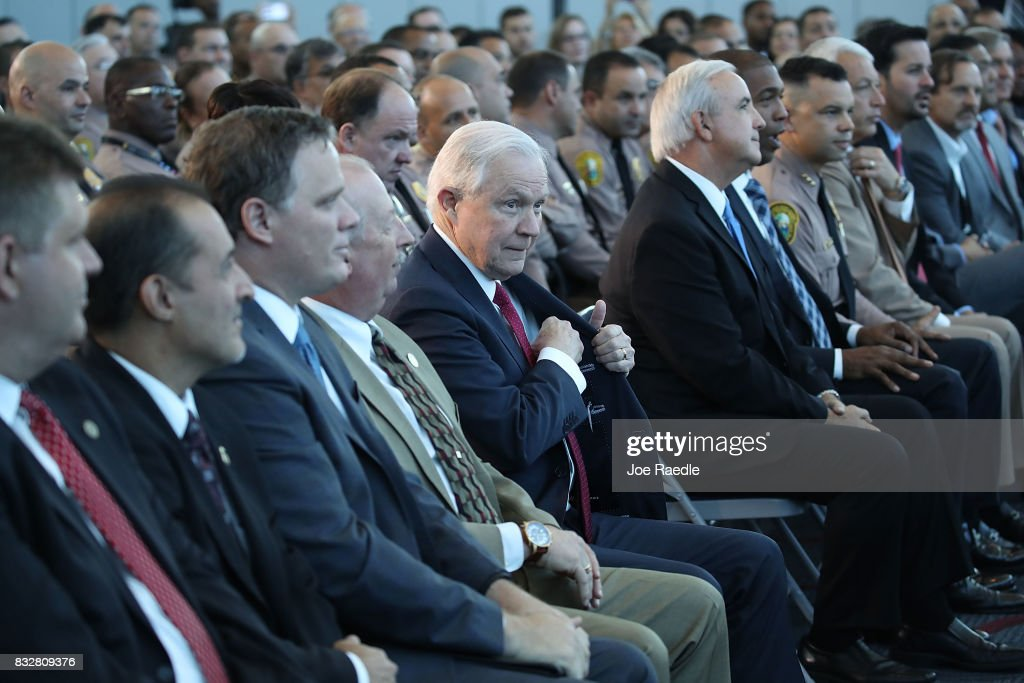 U.S. Attorney General Jeff Sessions waits to be introduced to speak at PortMiami on what he said is a growing trend of violent crime in sanctuary cities on August 16, 2017 in Miami, Florida. The speech highlighted jurisdictions like Miami-Dade that Mr. Sessions told the audience have increased their cooperation and information sharing with federal immigration authorities and have demonstrated a fundamental commitment to the rule of law and lowering violent crime.