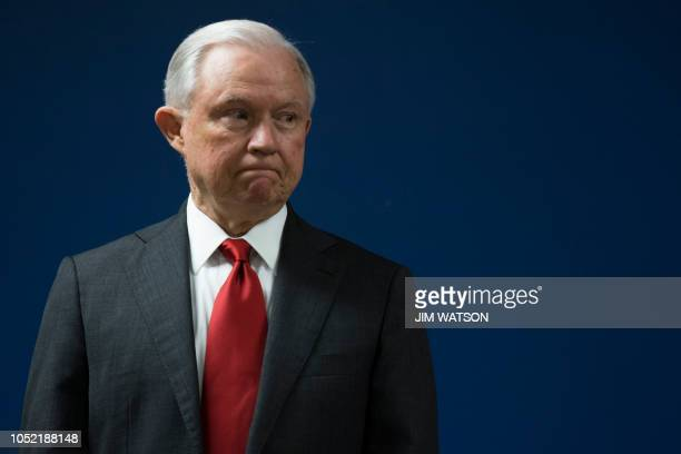 US Attorney General Jeff Sessions waits to make an announcement on efforts to reduce transitional crime during a press conference at the US...