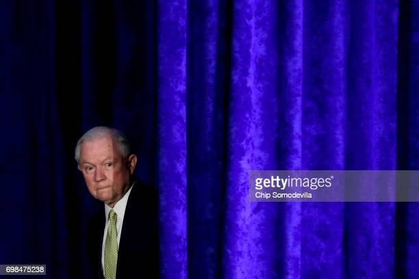 S Attorney General Jeff Sessions walks out from backstage during the National Summit on Crime Reduction and Public Safety at the Hyatt Regency hotel...