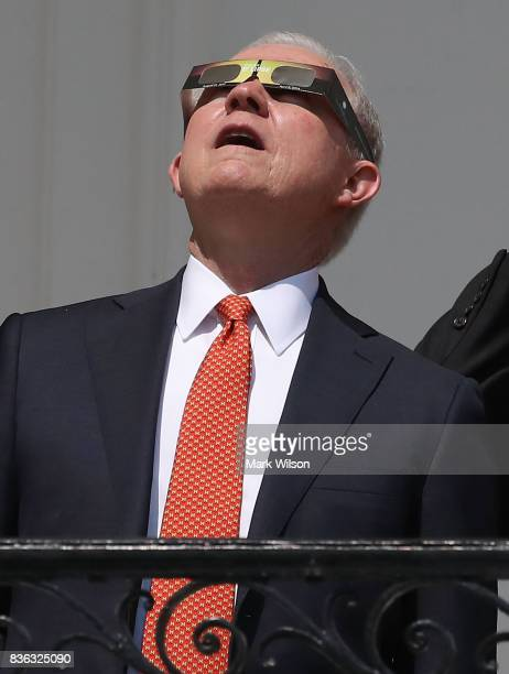 Attorney General Jeff Sessions wears special glasses to view the solar eclipseat the White House on August 21, 2017 in Washington, DC. Millions of...
