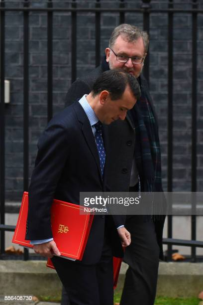 Attorney General Jeremy Wright and Scotland Secretary David Mundell leave following the weekly cabinet meeting at Downing Street on December 5 2017...