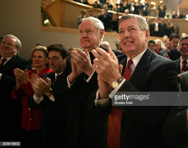 Attorney General John Ashcroft applauds United States President George W Bush before he signs legislation banning socalled 'partial birth' abortions...