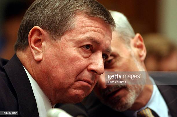 Attorney General John Ashcroft has a word with Michael Chertoff Assitant Attorney General at a House Judiciary Committee Hearing on new terrorism laws