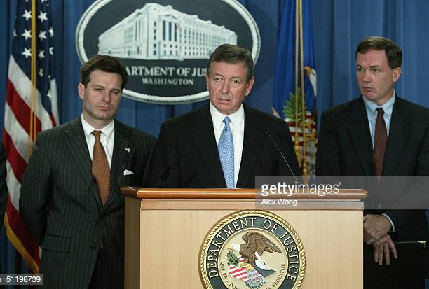 S Attorney General John Ashcroft speaks as US Attorney for the Northern District of Illinois Patrick Fitzgerald and Assistant Attorney General for...