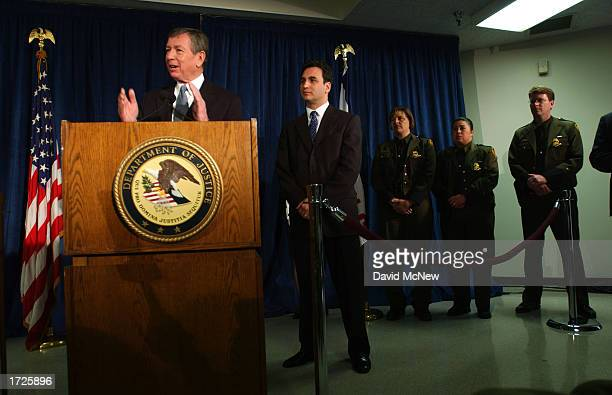 S Attorney General John Ashcroft speaks at a news conference as Michael Garcia acting commissioner of the Immigration and Naturalization Service...