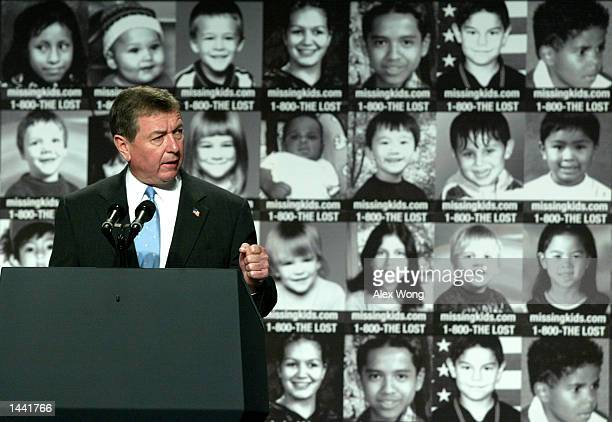 Attorney General John Ashcroft speaks during a White House Conference on Missing, Exploited, and Runaway Children October 2, 2002 in Washington, DC....