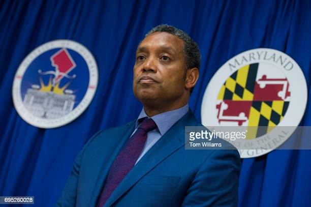 C Attorney General Karl Racine and Maryland Attorney General Brian Frosh off camera conduct a news conference on a lawsuit they've filed against...