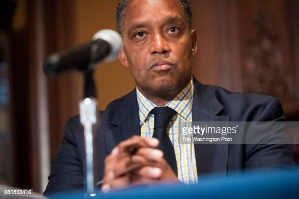 Attorney General Karl Racine OAG listens during a signing to transfer funds to the OAG to be used for the hiring of additional attorneys and enhanced...