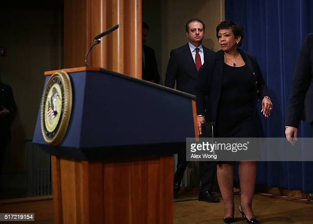 S Attorney General Loretta Lynch and US Attorney Preet Bharara of the Southern District of New York arrive at a news conference for announcing a law...