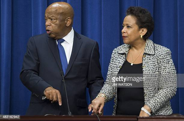 US Attorney General Loretta Lynch and US Congressman John Lewis DGeorgia look for their seats as US President Barack Obama prepares to deliver...