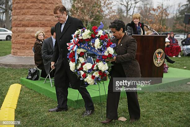 S Attorney General Loretta Lynch and Victims of Pan Am Flight 103 President Frank Duggan place a wreath at the Lockerbie Carin during a memorial...