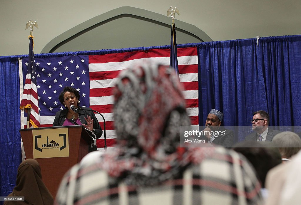 U.S. Attorney General Loretta Lynch (L) delivers a speech at the All Dulles Area Muslim Society (ADAMS) Center as Executive Religious Director Imam Mohamed Magid (2nd R) listens December 12, 2016 in Sterling, Virginia. Lynch spoke to religious leaders and community members about the Department of Justice's efforts to combat hate crimes.