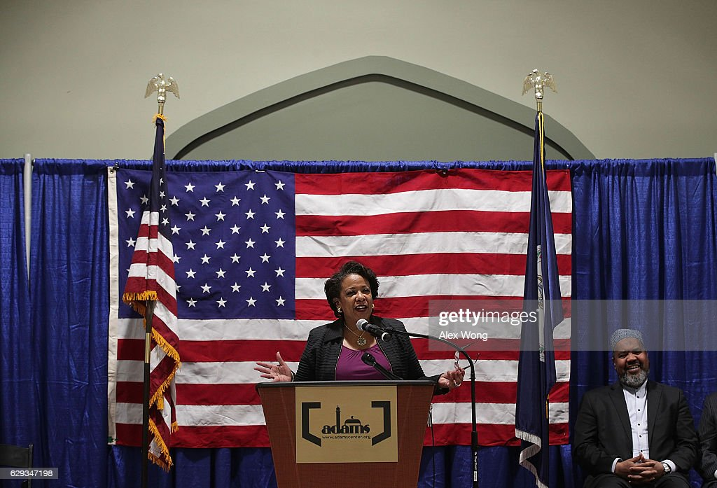 U.S. Attorney General Loretta Lynch (L) delivers a speech at the All Dulles Area Muslim Society (ADAMS) Center as Executive Religious Director Imam Mohamed Magid (R) listens December 12, 2016 in Sterling, Virginia. Lynch spoke to religious leaders and community members about the Department of Justice's efforts to combat hate crimes.