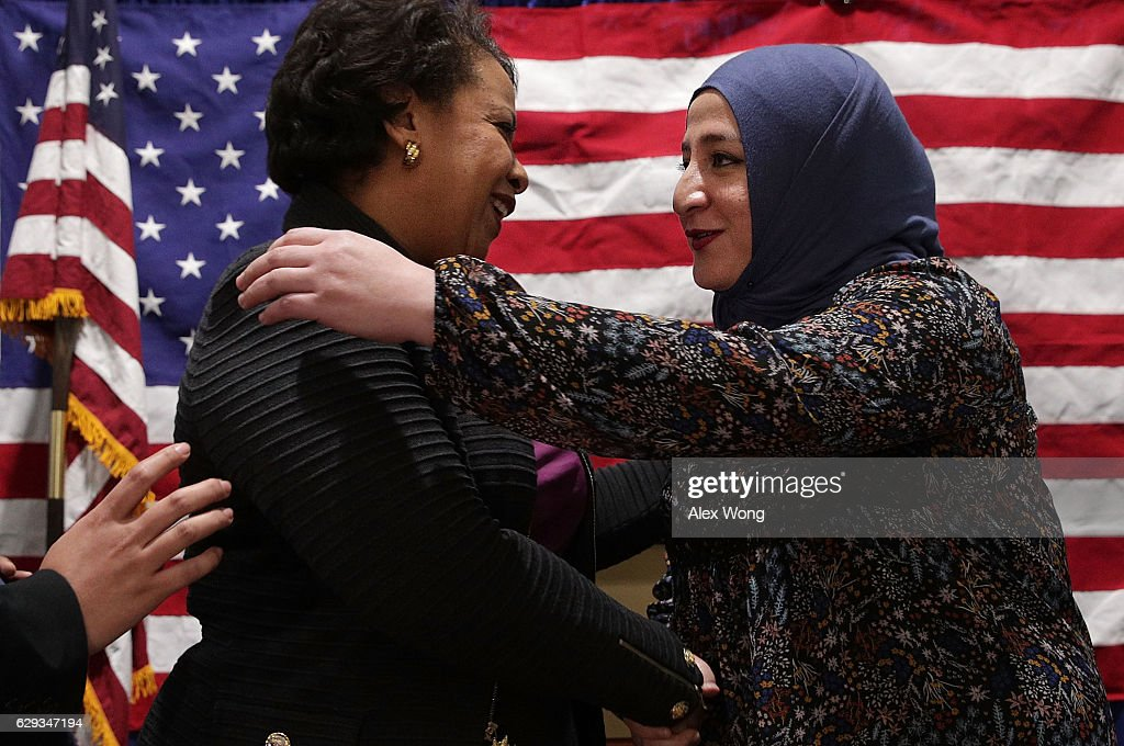 U.S. Attorney General Loretta Lynch (L) is greeted by director of All Dulles Area Muslim Society (ADAMS) Center's BEAT Choir Hurunnessa Fariad (R) during an event December 12, 2016 in Sterling, Virginia. Lynch spoke to religious leaders and community members about the Department of Justice's efforts to combat hate crimes.