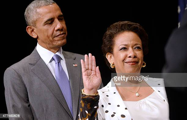 Attorney General Loretta Lynch is sworn in during a formal investiture ceremony as US President Barack Obama looks on at the Warner Theatre June 17...