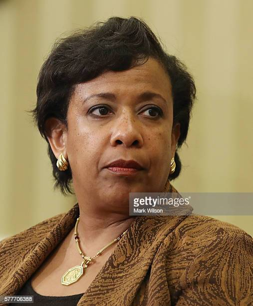 S Attorney General Loretta Lynch listens to President Barack Obama speak to the media in a meeting also attended by FBI Director James Comey in the...