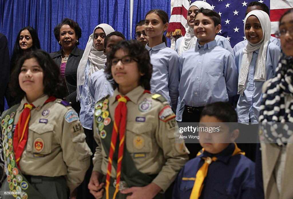 U.S. Attorney General Loretta Lynch (2nd L) poses for a group photo with young members of All Dulles Area Muslim Society (ADAMS) Center during an event December 12, 2016 in Sterling, Virginia. Lynch spoke to religious leaders and community members about the Department of Justice's efforts to combat hate crimes.
