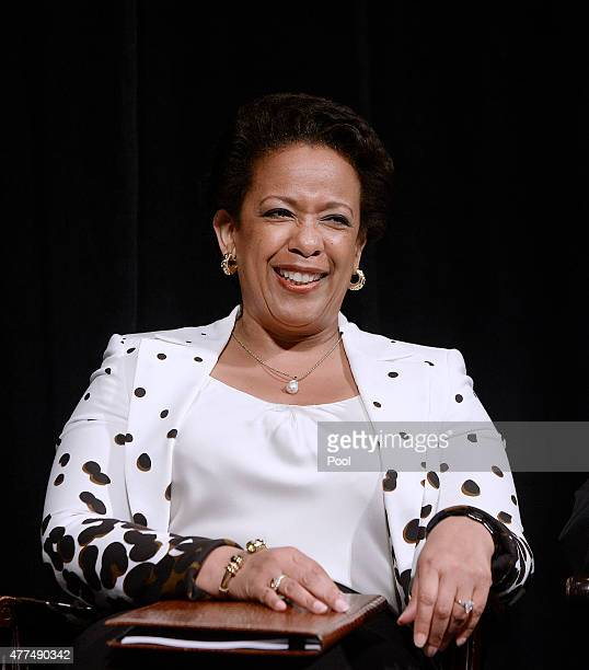 Attorney General Loretta Lynch reacts to US President Barack Obama's speech during a formal investiture ceremony at the Warner Theatre June 17 2015...