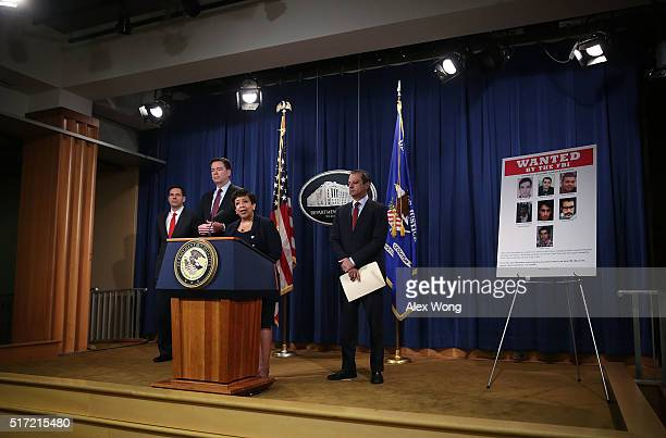 S Attorney General Loretta Lynch speaks as FBI Director James Comey Assistant Attorney General for National Security John Carlin and US Attorney...