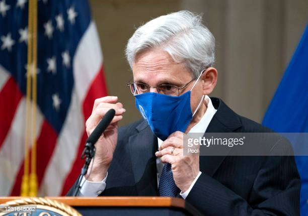 Attorney General Merrick Garland adjusts his mask after addressing the staff on his first day at the Department of Justice March 11, 2021 in...