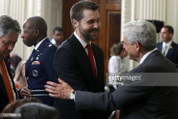 Attorney General Merrick Garland greets National Economic Council Director Brian Deese prior to an event at the State Dining Room of the White House...