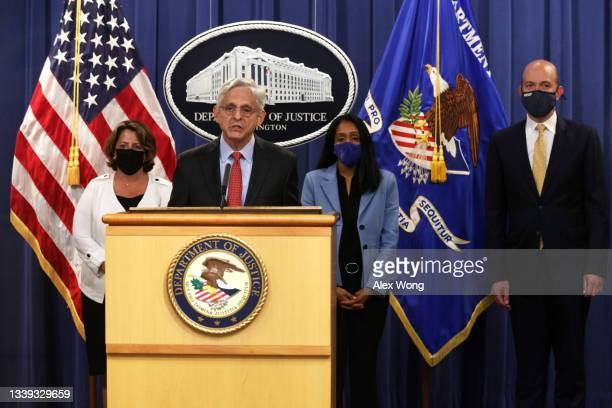 Attorney General Merrick Garland speaks as Deputy Attorney General Lisa Monaco , Associate Attorney General Vanita Gupta and Deputy Assistant...
