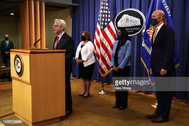 Attorney General Merrick Garland speaks as Deputy Attorney General Lisa Monaco, Associate Attorney General Vanita Gupta and Deputy Assistant Attorney...