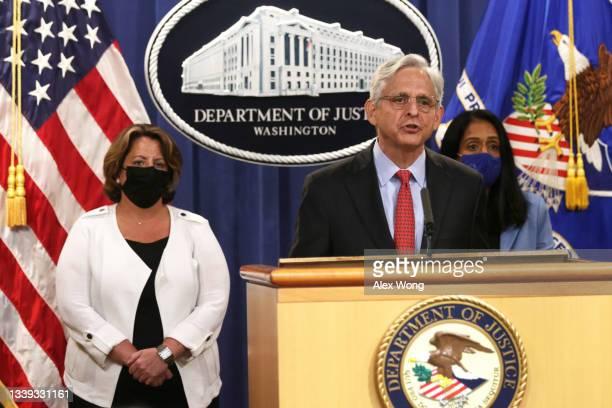Attorney General Merrick Garland speaks as Deputy Attorney General Lisa Monaco and Associate Attorney General Vanita Gupta listen at a news...