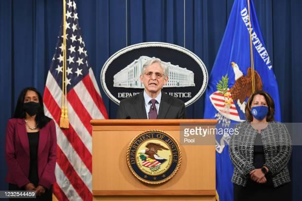 Attorney General Merrick Garland speaks at the Department of Justice alongside Associate Attorney General Vanita Gupta and Deputy Attorney General...