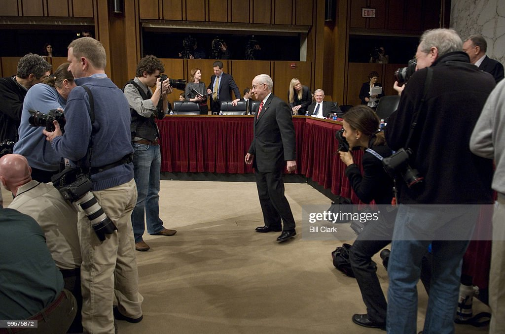 Attorney General Michael Mukasey makes his way back to the witness table after greeting members of the Senate Judiciary Committee before the start of the hearing on 'Oversight of the U.S. Department of Justice' on Wednesday, Jan. 30, 2008.
