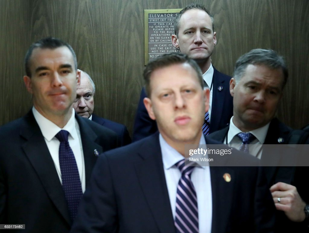 Attorney General nominee, Sen. Jeff Sessions (R-AL), (2ndL) is surrounded by security officers in an elevator after leaving a Senate Energy and Natural Resources committee hearing on Capitol Hill, January 31, 2017 in Washington, DC. The committee met to vote on the nomination of Rep. Ryan Zinke (R-MT) to be Interior Secretary, and former Gov. Rick Perry (R-TX) to be Energy Secretary.