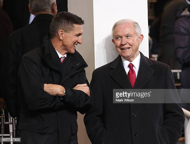 Attorney General nominee Sen Jeff Sessions talks with National Security Advisor Michael Flynn inside of the inaugural parade reviewing stand in front...