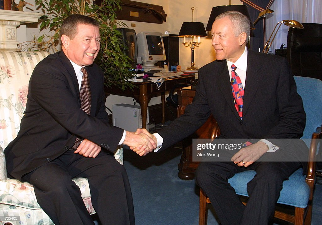 Attorney General nominee Sen. John Ashcroft shakes hands with Senate Judiciary Committee Chairman Sen. Orrin G. Hatch during their meeting January 3, 2001 on Capitol Hill in Washington, DC.
