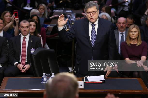 S Attorney General nominee William Barr is sworn by Senate Judiciary Committee chairman Lindsey Graham prior to Barr testifying at his confirmation...