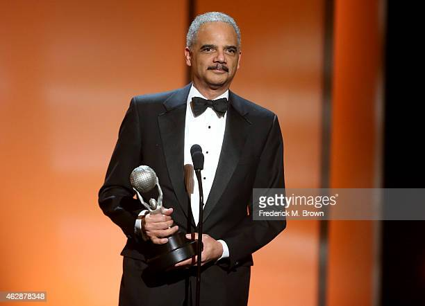 Attorney General of the United States Eric H Holder Jr accepts the Chairman's Award onstage during the 46th NAACP Image Awards presented by TV One at...