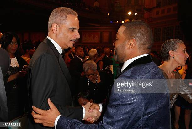 Attorney General of the United States Eric H Holder Jr and actor Anthony Anderson attend the 46th NAACP Image Awards presented by TV One at Pasadena...