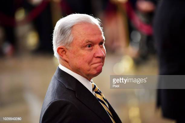 Attorney General of the United States Jeff Sessions stands as the casket of former Senator John McCain in the Capitol Rotunda lies in state at the US...