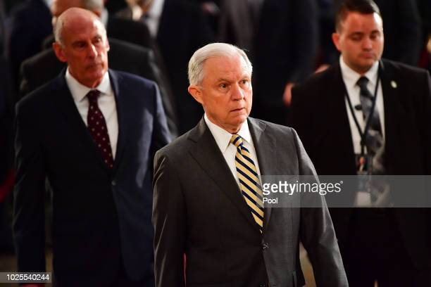 Attorney General of the United States Jeff Sessions walks as the casket of former Senator John McCain in the Capitol Rotunda lies in state at the US...