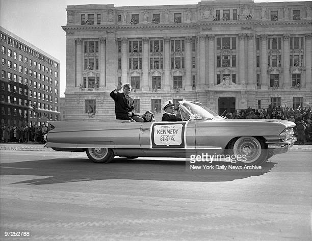 Attorney General Robert F Kennedy and his wife Ethel ride in the inaugural parade
