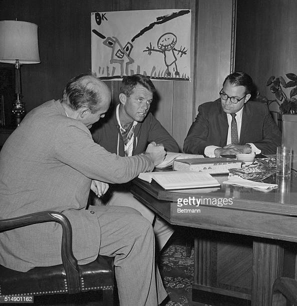 Attorney General Robert F Kennedy confers here in his office with two of his assistants Nicholas B Katzenbach Assistant Attorney General in charge of...