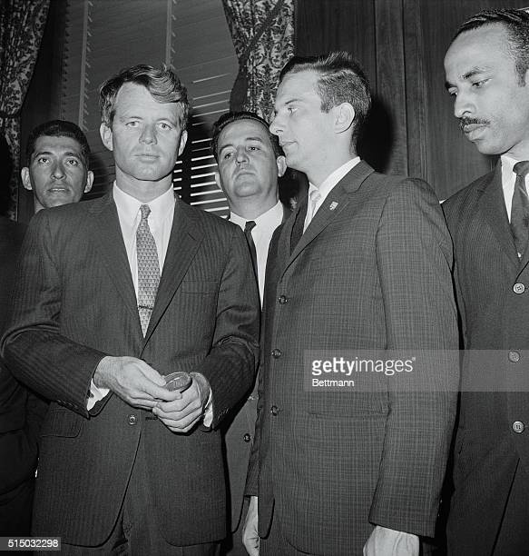 Attorney General Robert F Kennedy holds medallion presented to him today by Jose A Perez commander of the 2506 Brigade from the Cuban Bay of Pigs...