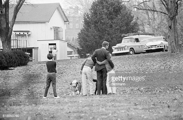 Attorney General Robert F Kennedy is comforted by two of his children here on the lawn of his home today after he had been notified of the...