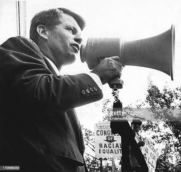 Attorney General Robert Kennedy addresses civil rights demonstrators in front of the Justice Deaprtment today Washington DC June 14 1963